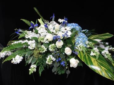 Serene Blue and White Casket Spray